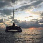 Surf catamaran sunset