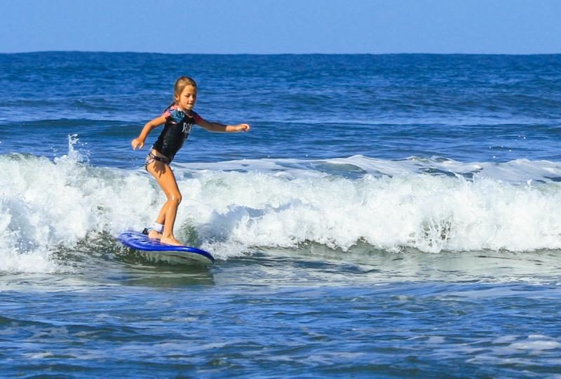 Girl Surfing Nosara